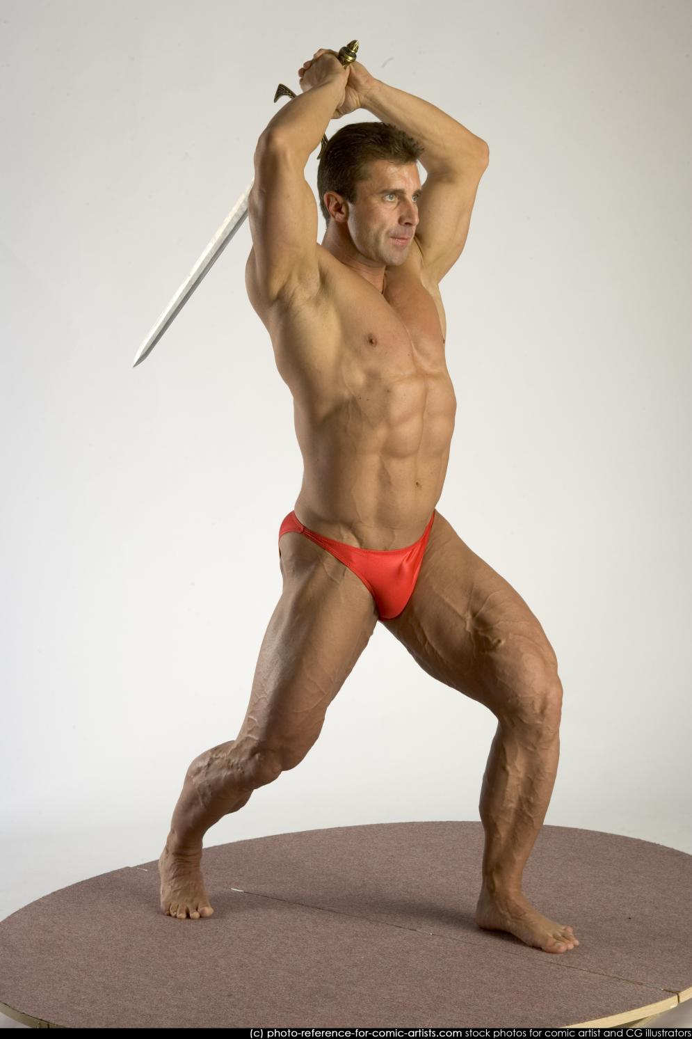 Image from Aggressive Muscular Guys - 292bodybuilder2_sword_attack_0007.jpg